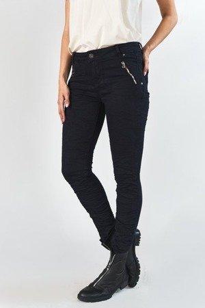 Женские черные джинсовые брюки с рюшами - Одежда